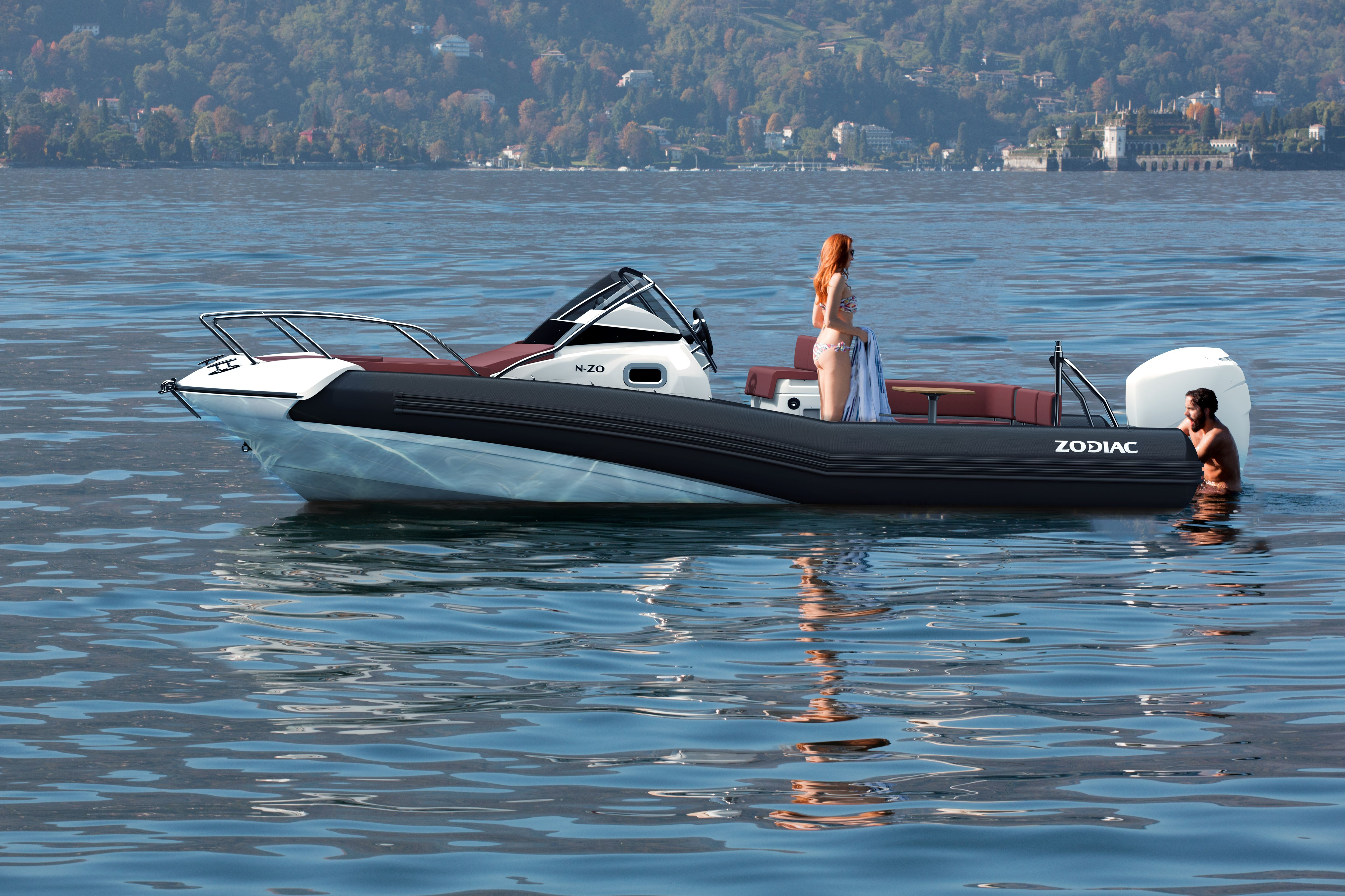 Zodiac nzo 700 cabin RIB boat floating in water with passengers