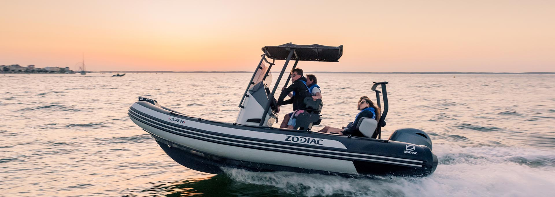 zodiac open 5.5 boat on the water at sunset