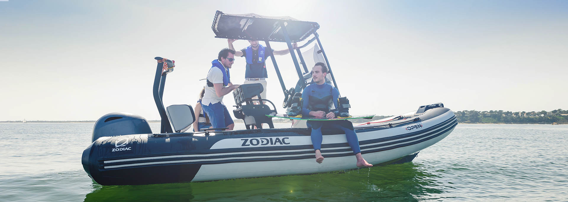 Zodiac Open 5.5 boat floating on the water with wakeboarder